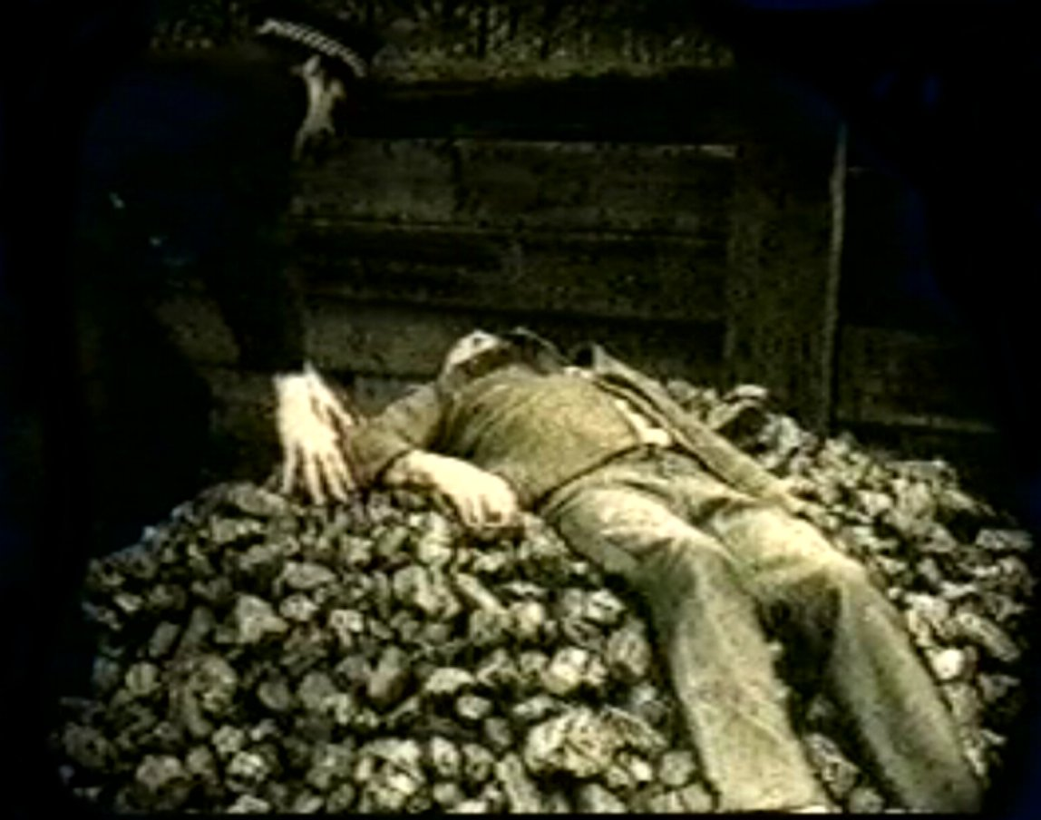 Mr Adamski's body atop the pile of coal
